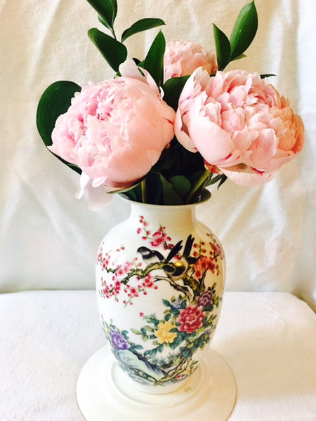 Beautiful pink peonies in a melon shaped Chinese vase