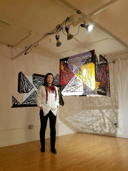 Artist Xin Song poses in front of her installation piece