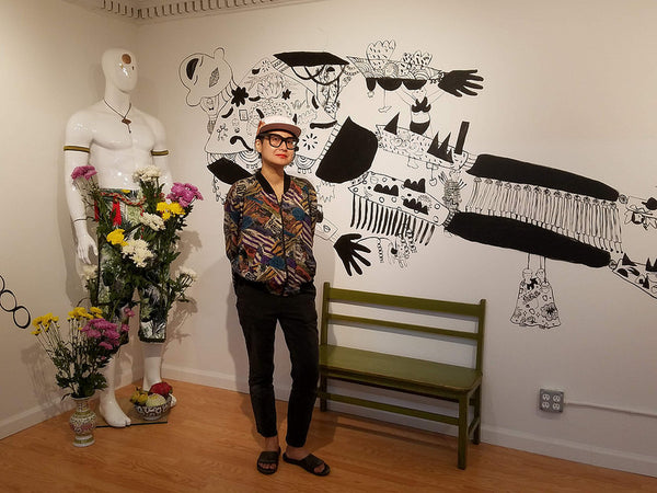 Former Pearl River artist-in-residence Yumi Sakugawa in front of her mural