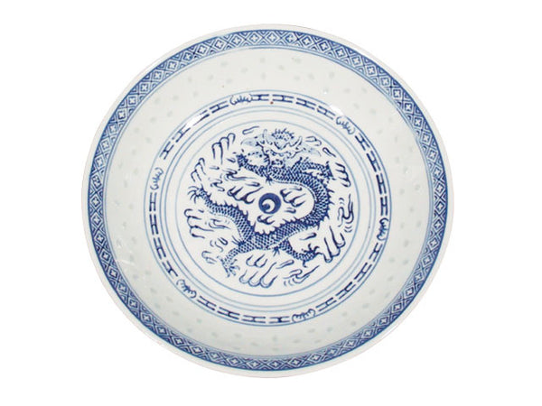 A vintage white plate with dark blue accents around a powerful dragon perfect for any meal