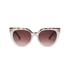 Front view of sunglasses with nude frame with brown tortoise trim and brown gradient lens