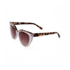 Side view of sunglasses with nude frame with brown tortoise trim and brown gradient lens