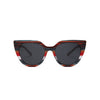 Front view of sunglasses with red multistripe frame solid black lens