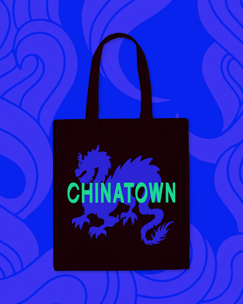 "Black tote bag with blue dragon design and ""Chinatown"" in green"