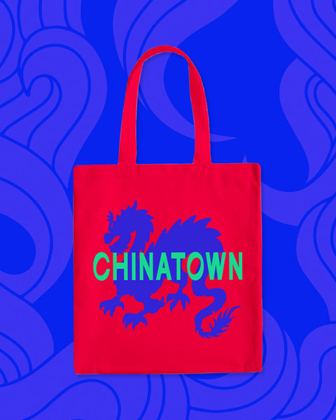 "Red tote bag with blue dragon and ""Chinatown"" in green"
