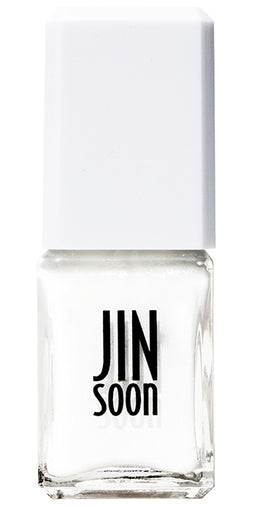 Bottle of bright white, shining nail polish