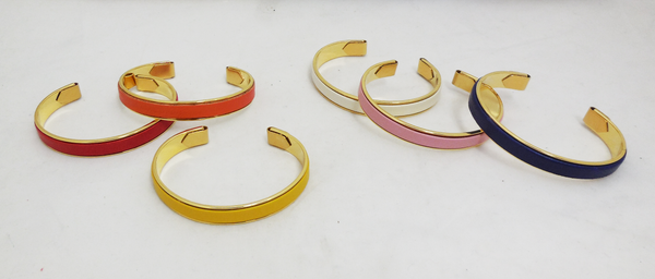 Array of colorful leather and gold-plated bangles
