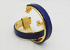 Close up of blue leather and gold-plated hoop earrings