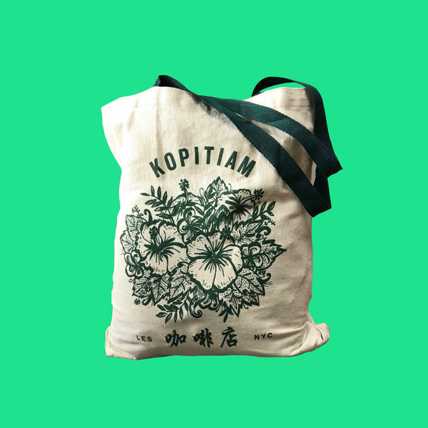 Green and taupe tote bag that says Kopitiam