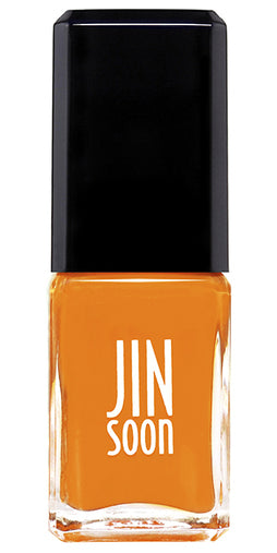 Bottle of cheerful orange nail polish