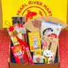 A gift box with Pearl River's favorite items including Pocky, lucky coin ornament, lucky cat, chopsticks, a fan, white rabbit candy, tiger balm, a cute luggage tag, and a 4-pack Bee & Flower soap