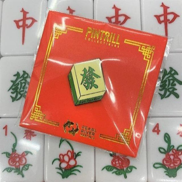 "Mahjong ""fortune"" pin with a background of mahjong tiles"