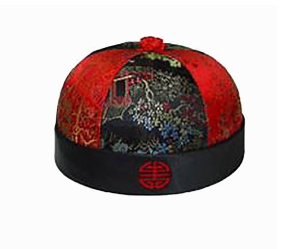 cultural round hat with alternating red - black brocade panels and a medallion on the rim