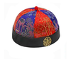 cultural round hat with alternating red - blue brocade panels and a medallion on the rim