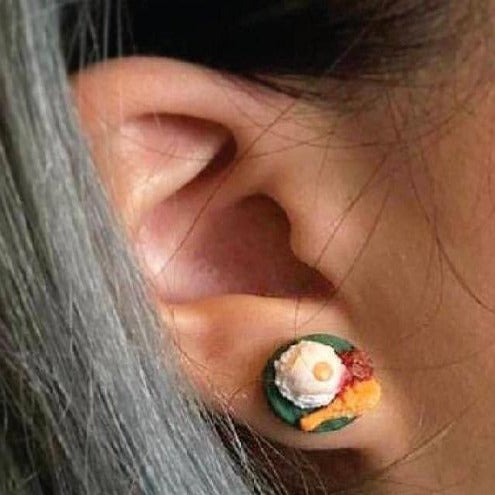 Woman wearing nasi lemak earrings