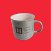 Jade-colored mug with the MOCA logo