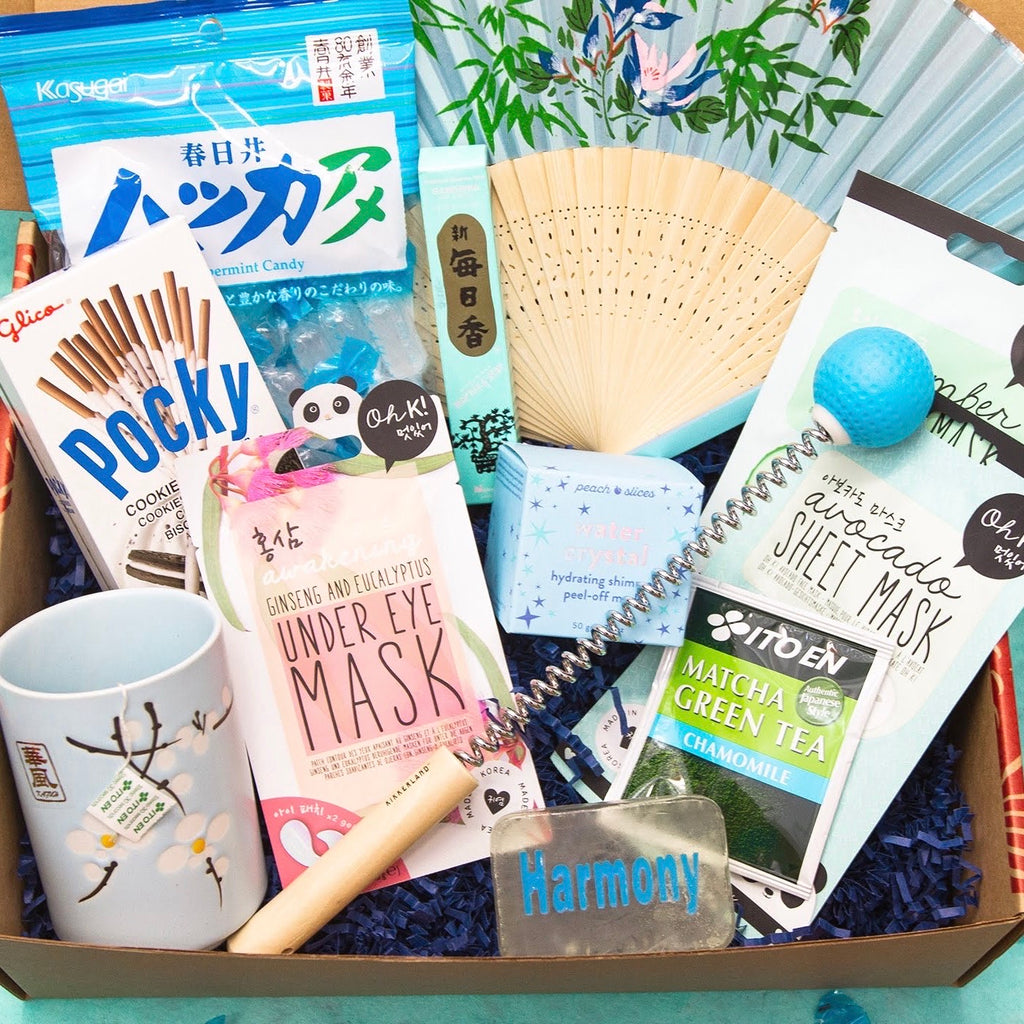 Friendship Box with mint candy, Pocky, tea cup, K-beauty sheet masks, fan, handheld massager, soap