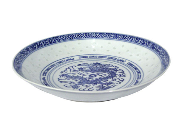 A vintage white deep plate with dark blue accents around a powerful dragon perfect for any meal