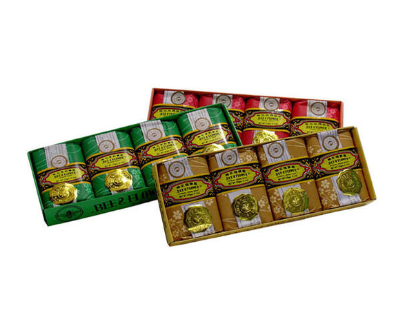 Three boxes of fragrant hand soap in gold, green, and red