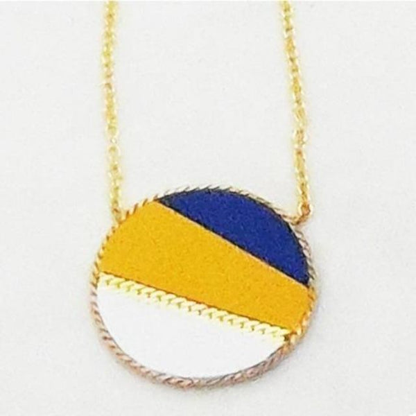 Close up of blue, yellow, and white leather and gold-plated disk necklace