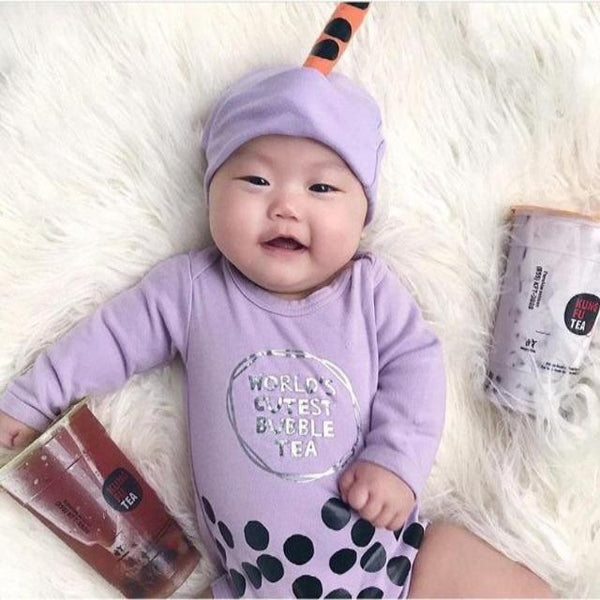 "Adorable baby in purple ""bubble tea"" onesie"