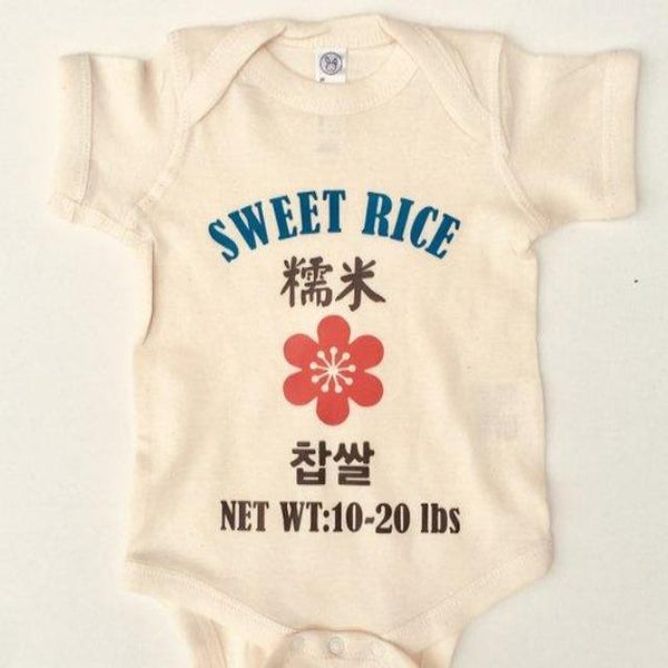 Adorable white onesie that says Sweet Rice and includes Chinese and Korean characters