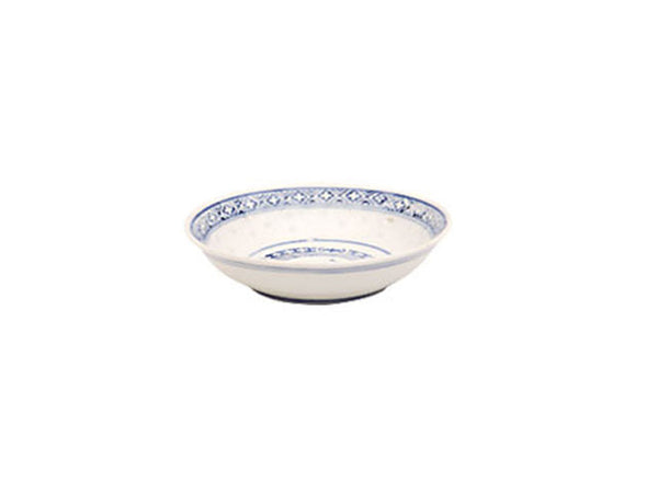 A vintage white sauce dish with dark blue accents around a powerful dragon perfect for any meal