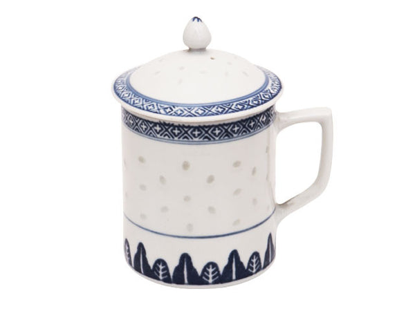 A vintage white mug and lid with dark blue accents and translucent rice grains perfect for a cozy day in