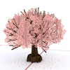 Close-up of paper sakura tree with pink blossoms