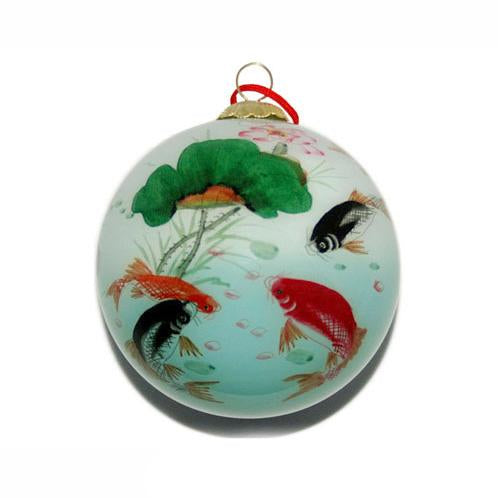 Holiday ornament with black, orange, and red koi swimming in a lotus pond