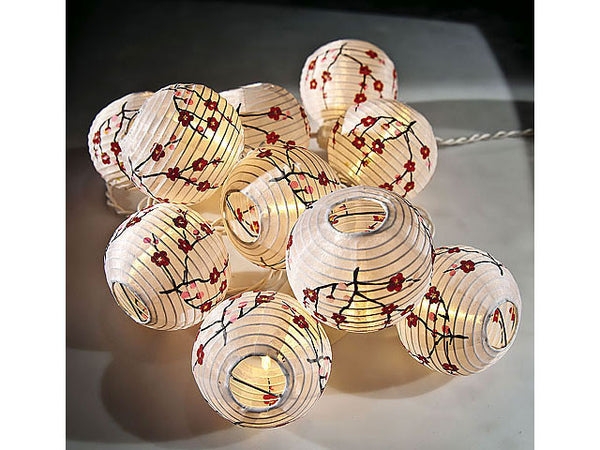 Pretty small white paper lanterns with red cherry blossoms