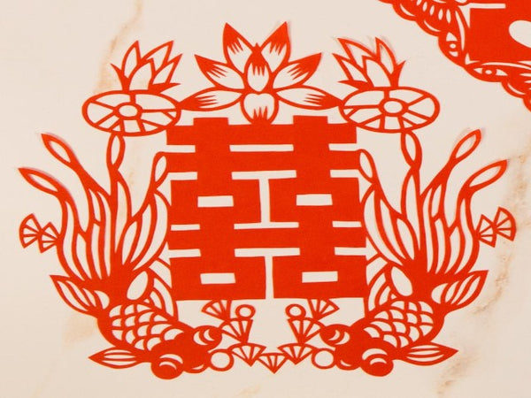 Red paper cut decoration with Chinese double happiness character and good luck fish