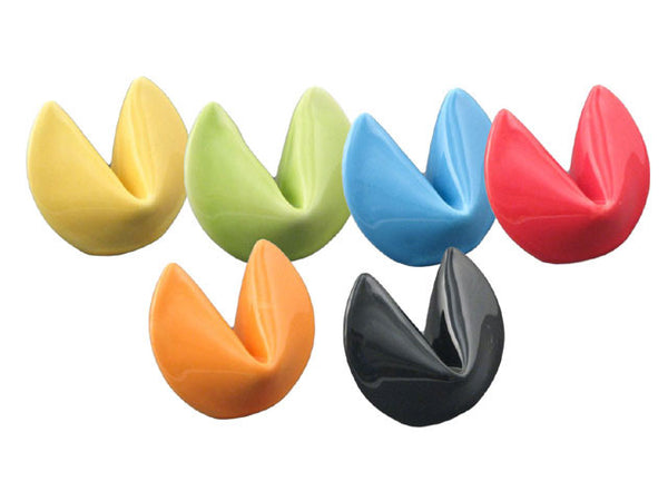Rainbow array of six fortune-cookie-shaped porcelain chopstick holders