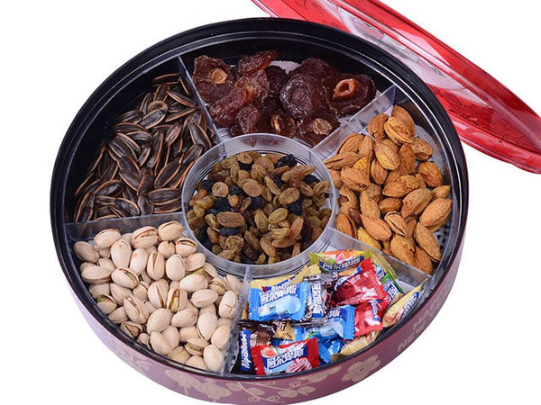 Festive round treat holder with a variety of Asian goodies