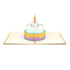Fun pop-up card with colorful birthday cake with candle