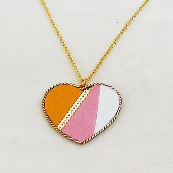 Close-up of pink, yellow, and white heart necklace
