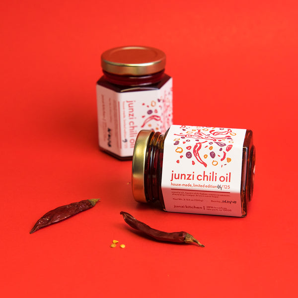 2 jars of Junzi Chili Oil with red chili peppers