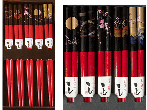 Package of beautiful red chopsticks each with different night scene artwork