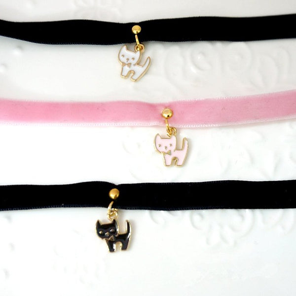 Adorable velvet chokers in black and pink velvet with white, pink, and black cat pendants