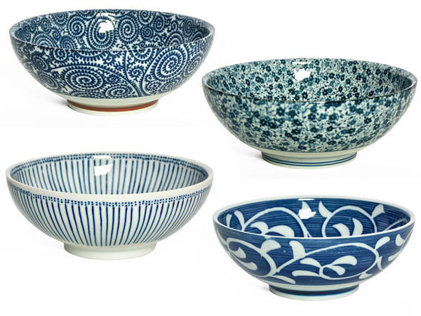 A set of four ornately designed blue and white bowls perfect for any meal or snack