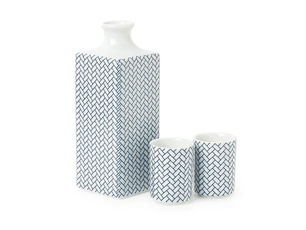 "Item: MIY-J4810  Blue and white is the new neutral. This basket weave pattern is made more modern on this simple and beautiful sake set. Packaged in a gift box.  Sake bottle: 2.5"" square x 6.5""h; 14 oz. capacity. Sake cup: 1.75"" diameter x 2.25""h; 1 oz. capacity. Ceramic. Microwave, dishwasher safe. Made in Japan. Please note some of the glaze/pattern may seem slightly irregular. This is not a defect."