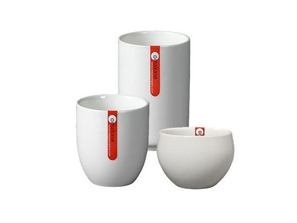 A collection of chic white ceramic cup and mugs