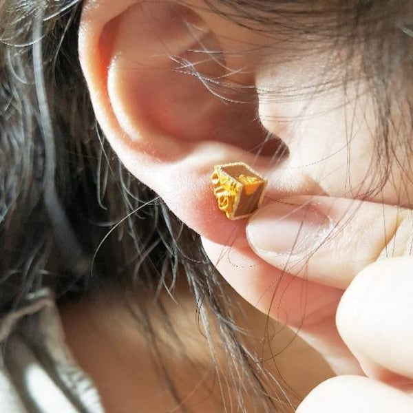 Woman wearing mooncake earrings