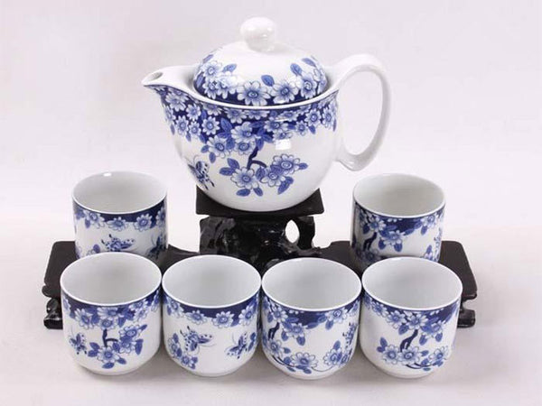 White tea pot and six cups with pretty blue blossom design