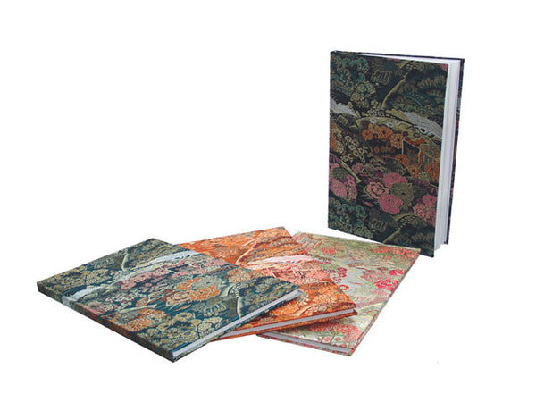 Four brocade notebooks in a variety of beautiful designs