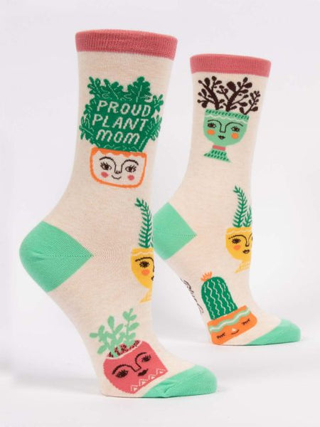 Pink and green socks that say proud plant mom