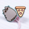 Close up of cute earbuds with Pusheen and pizza charms