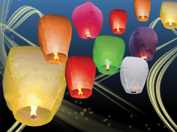 Ten beautiful multicolored lanterns lit up and floating together
