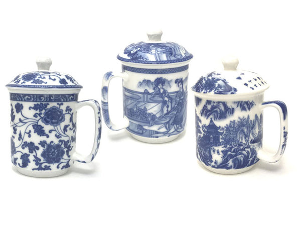 Three blue and white mugs with lids with various ornate designs of florals and landscapes