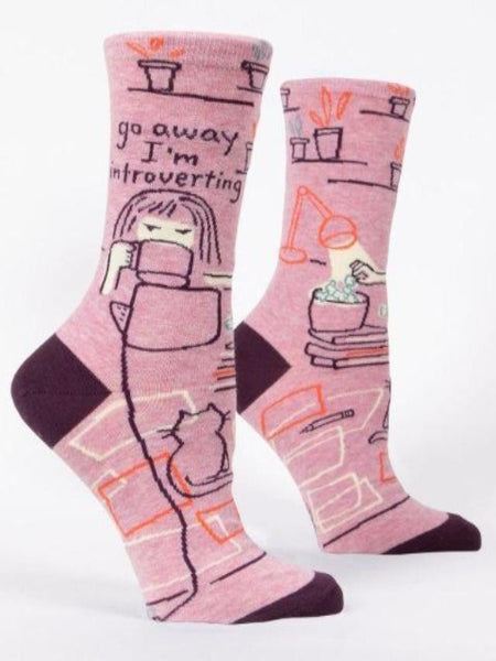 "Pink women's socks with woman with mug and text, ""Go away I'm introverting"""